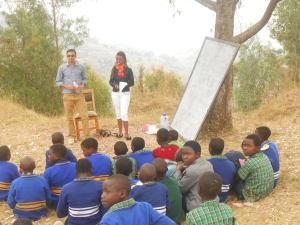 The children sponsored by Compassion International concentrating hard on John (left) and Gisele's (right) lesson.
