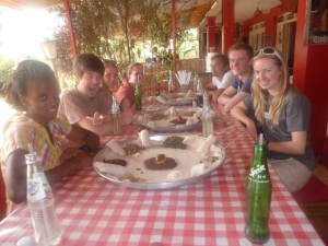 No cutlery, (un-fork-tunate Jenny) at the Ethiopian restaurant in Kigali with (left to right) Gisele, Matt, Beth, Katie, John, Mich and Jenny