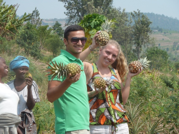 John (front-left) and Beth (front Right) Showcasing the Pineapples from Ruhango/Tambwe - Dufashanye Cooperative supported by RDIS
